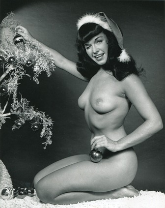 Bettie Page in Santa hat, the first Bunny Yeager shot to run in Playboy magazine, 1954
